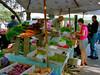 A farmer sells his produce at the Burlington VT Farmers Market