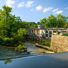 view of paper mill from covered bridge