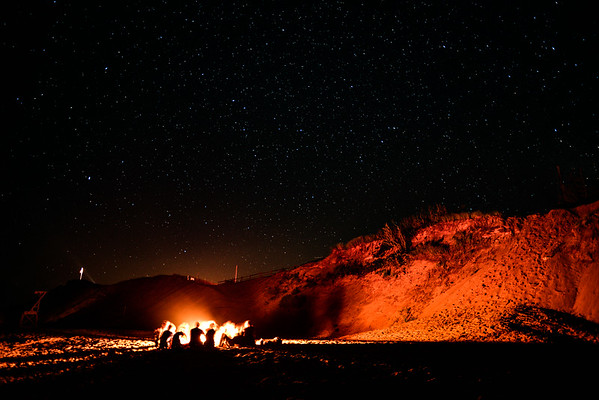 A bonfire under the stars on a summer night at Cape Cod National Seashore, MA