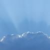 Sun nursing through the clouds