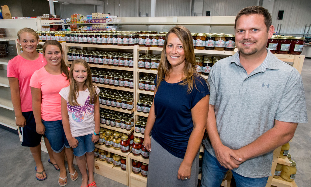 . Esh\'s Grocery Market owners Reuben Esh, right, and his wife Martha Esh, pose Wednesday afternoon July 13, 2016 at the company\'s new location at 375 W. 71st St., in north Loveland, with their daughters, from left, Carolyn, Talitha, and Bethany. (Photo by Michael Brian/Loveland Reporter-Herald) (Photo by Michael Brian/Loveland Reporter-Herald)