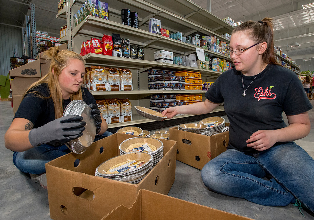 . Cheyenne Carver, left, from Evans, and Jessica Remmele, right, from Loveland, sort and price grocery items Wednesday afternoon July 13, 2016 at the new Esh\'s Grocery Market location at 375 W. 71st St., in north Loveland.  (Photo by Michael Brian/Loveland Reporter-Herald)