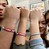 "With a heavy heart due to these terrible and senseless shootings at Marjory Stoneman Douglas High School in Parkland, Fla., Superintendent Andre Ravenelle has designed custom red and gray silicon wristbands with the phrase ""Red Raider Kindness"" and the word ""Remember"" on the reverse side.<br /> ""I have had wristbands made to be distributed to all students and staff,"" Superintendent Ravenelle said. ""'Red Raider Kindness' is a gentle reminder of something we can all do to enhance emotional wellness in our schools. I also have chosen the word, 'Remember' as to be kind or the many victims of violence."" Freshmen Markel Pagan, 15, Olivia Tran, 14, and Estelle Arseneau, 14, show of their wristbands they got on Thursday afternoon at the school. SENTINEL & ENTERPRISE/JOHN LOVE"