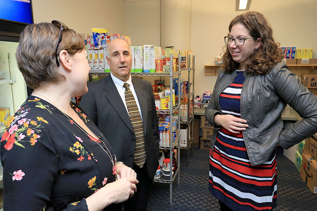. The new Fitchburg State University Falcon Bazaar food pantry to help students in need held a ribbon cutting on Tuesday, October 16, 2018. State Rep. Natalie Higgins, right, chats with Administrative Assistant for Housing and Residential Services Heather Massaferro and FSU President Richard Lapidus during her visit to the pantry during the rtibbon cutting. SENTINEL & ENTERPRISE/JOHN LOVE