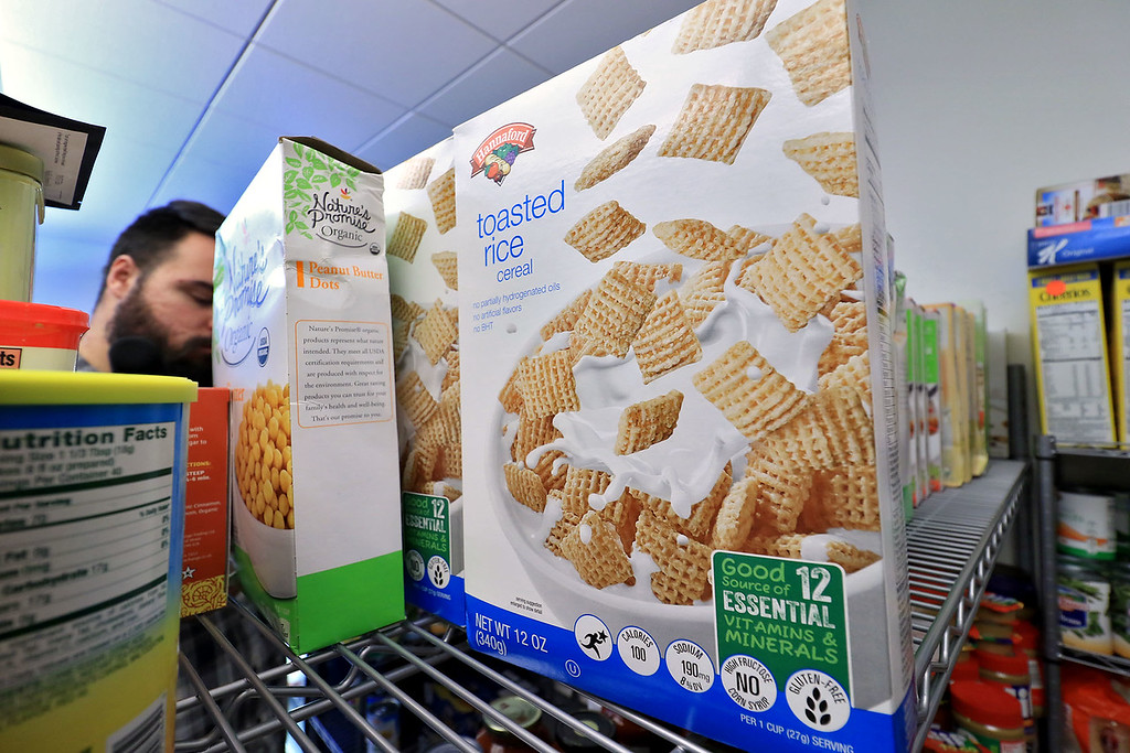 . The new Fitchburg State University Falcon Bazaar food pantry to help students in need held a ribbon cutting on Tuesday, October 16, 2018. They have gotten about 1000 pounds of food like this box of toasted rice cereal.  SENTINEL & ENTERPRISE/JOHN LOVE
