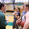 New coach talks to girls .  R- L  Catherine Coppinger and Katelynn Rizzutl and  Hannah Keouhan during practice