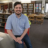 The new Fitchurg Teen Librarian Colin Welch in their teen room Tuesday afternoon, August 13, 2019. SENTINEL & ENTERPRISE/JOHN LOVE