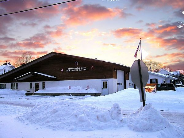The New Glarurs EMS center, in the evening after a snowstorm