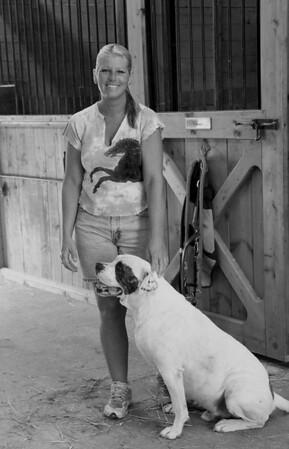 Sherry in the stable with her dog.