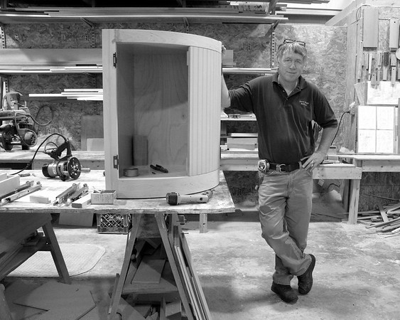 Steve - master cabinet buider with curved cabinet.