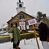 KRISTOPHER RADDER — BRATTLEBORO REFORMER<br /> Richard Mellon and Tom Duston hold up signs for Democratic presidential candidate Sen. Elizabeth Warren, D-Mass.,  outside the Chesterfield Town Hall during the New Hampshire presidential primaries on Tuesday, Feb. 11, 2020.