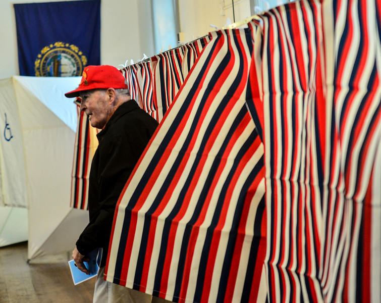 KRISTOPHER RADDER — BRATTLEBORO REFORMER<br /> William J. Patenaude, a Korean and Vietnam veteran and resident of Chesterfield, N.H. leaves the voting booth with his ballot in hand at the Chesterfield Polling Station inside the Town Hall during the New Hampshire presidential primaries on Tuesday, Feb. 11, 2020.