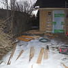 More piles of wood all over the place as the project goes on and the snow doesn't melt.