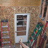 The door is temporary - until there is heat and some doors on the addition.  This will be a big opening with no door when it's done.  The cats are really happy to have a door into the addition again so they can go out there and get all dirty.