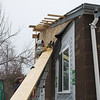 Okay - they got the saw and they are cutting up the house more - I like that the board is still wedge up next to the house during this.