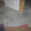 This is what happens when you give a 16 year old boy a marker and tell him he can write on the walls and floor.  He was inspired to do this when he saw the builders were writing on the walls to figure out electrical stuff.