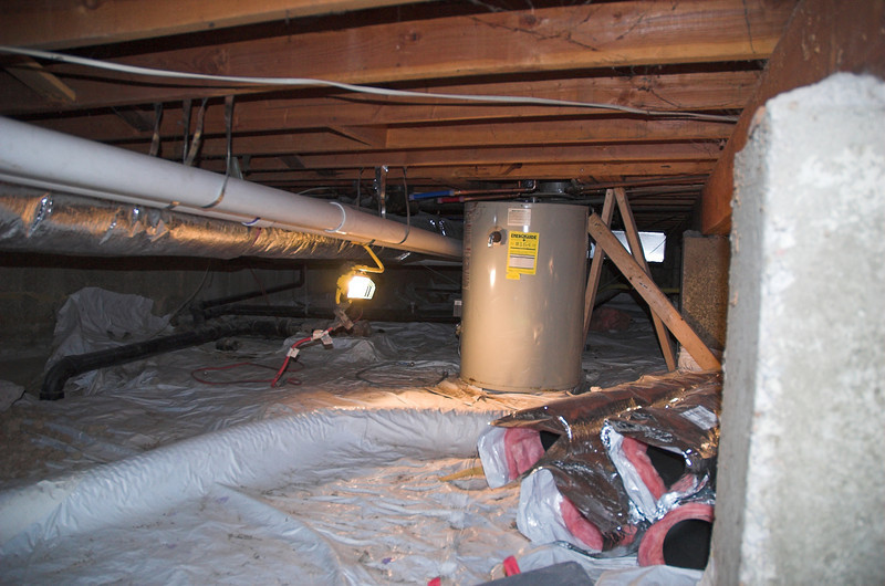The old hot water heater is still down here - but it's not doing anything but taking up space.  The white plastic stuff is for the radon mitigation system.  Makes for a not too yucky crawl space.