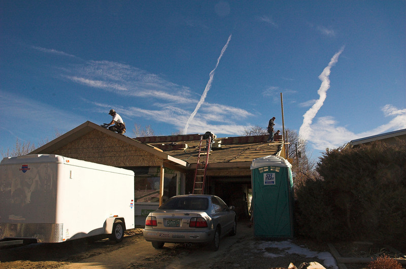 Cause it's roofing day!  Yay - it was over 60 today so good day to put on a roof (ignoring the wind).