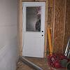 The garage door to the back yard.