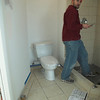 The plumber installed a toilet.  Then he was not so happy I took a photo of it with him standing there.