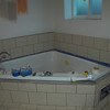 And tile around the tub!  And look the tub even does bathtub stuff like get water in it now.