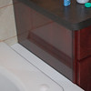 They put in a piece of tempered glass at the end of the cabinet to protect it from the water from the tub also.  Jim's clever design here.