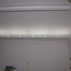 They are indirect fluorescents so they bounce the light up and off the ceiling - so no glare from the lights above.