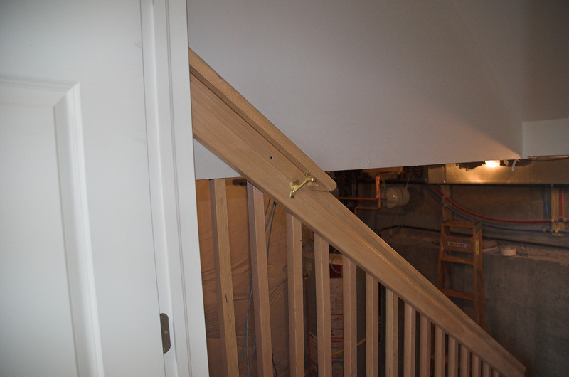 The top step to the basement gets it's own special handrail so we can pass inspection.
