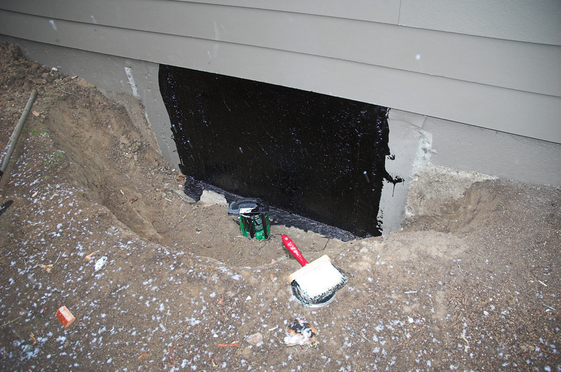 The old entrance to the crawl space is sealed up.  Jim had Carl cover it in tar - I think Carl still has tar on his hands as a result.