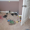 It's saturday but Jim and Carl both showed up - for what should have been just a few minutes.  Carl cut down the doors so they would fit over the carpet (like this one in the office).  Jim was going to do a quick setup of the datalines (the house was already wired with cat5 for an in house ethernet).  Turned out not to be a simple job as the house wasn't really wired completely.  Over 3 hours later and they managed to get my sons room up and running.  This was supposed to be the electricians job - he kinda didn't show up to do it.