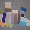 Most of the 19 colors that will be on the inside of the house.  Most are kwal paints but the brown and purple are from home depot (behr).  Bedrooms are the blues and purples, bathrooms are orange and green.  The rest of the house - mostly all open - is earthtones.