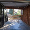 Same thing only looking through the garage from the front of the house.  <br /> <br /> If you are wondering about the black plastic on the wall in the garage - it is covering insulation that is on top of the wall board. Kinda icky.  This will be fixed at some point during the construction.