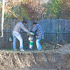 Jim and helper guy mucking with the tamper thing.