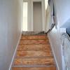 looking up basement stairway