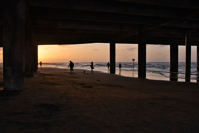 Silhouettes Under the Pier