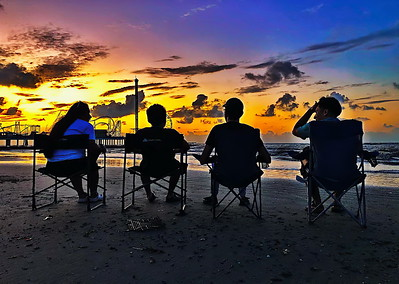 Family Watching the Sunrise on the Beachc