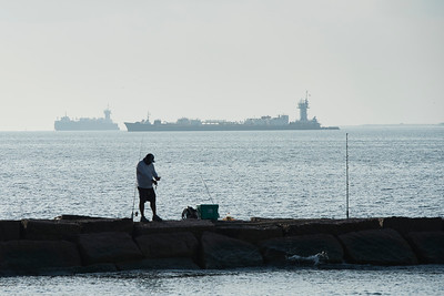 Fisherman at the Bolivar Ferry Jetty