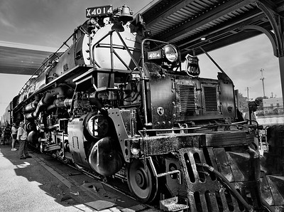 """Union Pacific 4014, also known as the """"Big Boy"""", is a steam locomotive owned and operated by the Union Pacific as part of their heritage fleet. It is a four-cylinder simple articulated 4-8-8-4 """"Big Boy"""" type built in 1941 by the American Locomotive Company of Schenectady, New York.  Dimensions The locomotives were 132 feet long and weighed 1.2 million pounds. Because of their great length, the frames of the Big Boys were """"hinged,"""" or articulated, to allow them to negotiate curves.  Stood on its end, a Big Boy would be the height of a 13-storey building. One weighs more than a Boeing 747 fully loaded with passengers and has the power to pull 16 Statues of Liberty over a mountain. Minus the tender, the Big Boy has the longest engine body of any reciprocating steam locomotive.   By today's standards, each Big Boy cost around $4.4 million to construct.  Advert Heritage Railway Subscription Why is it called the Big Boy? According to a Union Pacific executive, the class was originally to have been called the 'Wasatch'. However, one day while one of the engines was being built, an unknown worker scrawled 'Big Boy' in chalk on its front – and so the legendary name was born.  Speed They were tested at speeds between 70 and 80 m.p.h. In regular service, Big Boys were limited to a top speed of 55 m.p.h. That is a very large mass of iron coming down the tracks at a very high speed. From the time the engineer applied the brakes, until the time the Big Boy and train came to a complete stop was between 1 to 1.5 miles   'Big Boy' No. 4014 at rest, having arrive  Finally, as if the 4000s weren't big enough, the Union Pacific actually contemplated ordering five additional 4-8-8-4s that would be even larger.  Advert Steam on the Underground - Kindle As World War II dragged on, the Union Pacific needed additional power on its line to Los Angeles through southwest Utah. According to historian and artist Gil Bennett, plans were on the drawing board to build No. 4025-4029.  This third cla"""