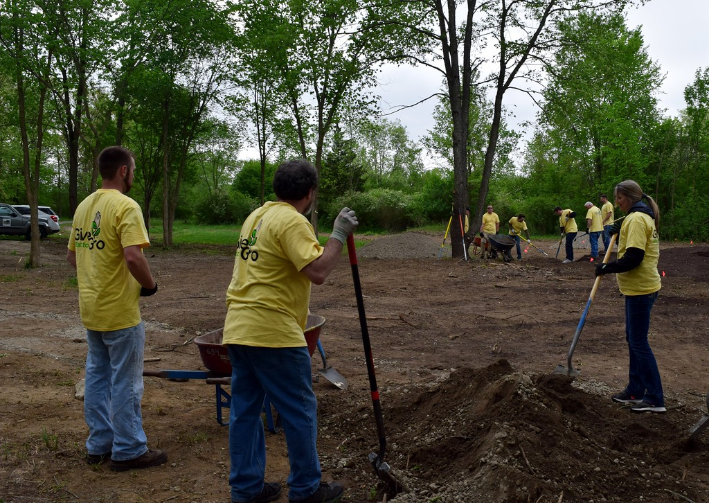 . Volunteers work on preparing the sensory garden for planting at Innovation Hills in Rochester Hills on Friday, May 19, 2017.