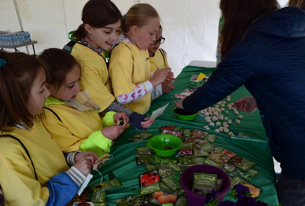 . Fourth graders from Hamlin Elementary learn how to plant seeds inside clay balls at Innovation Hills in Rochester Hills on Friday, May 19, 2017.