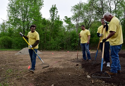 Volunteers work on preparing the sensory garden for planting at Innovation Hills in Rochester Hills on Friday, May 19, 2017.