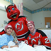 As an extension of the Love Your Melon night, Devils alumnus Bruce Driver and NJ Devil visit Newark Beth Israel, part of RWJBarnabas Health, to donate 100 Love Your Melon hats to children being treated at the hospital.