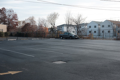 Empty parking lot on Avenue E in Constable Hook, Bayonne, New Jersey on November 26, 2016.  Photographed with a Fujifilm X-Pro2 and XF27mmF2.8 lens at 27 mm and  1/210 sec | ƒ / 5.6| ISO 200.  © Victoria and Michael Mroczek  R:\RAW\2016\11\11-26-16 Scarlett's First Walk\11262016-Scarlett-First-Walk-Mroczek-2.RAF