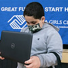 Jadiel Sanchez, 10, of Leominster looks over his new Dell Inspiron laptop at the Boys & Girls Club of Fitchburg and Leominster on Monday afternoon. 100 laptops were donated by Comcast, 75 went to the club in Leominster and 25 went to the club in Gardner. SENTINEL & ENTERPRISE/JOHN LOVE