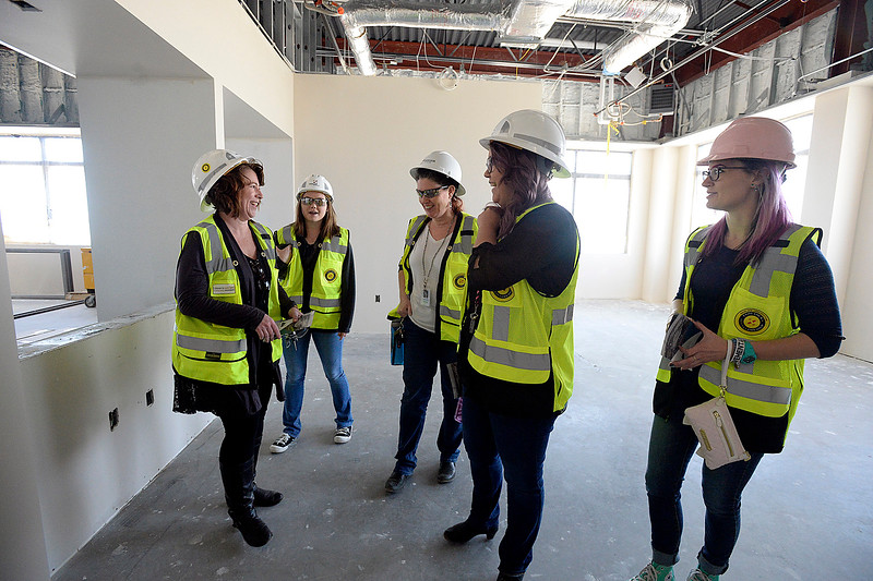 Larimer County human services employees check out their new workspace in the new Larimer County building under construction Friday, April 27, 2018, in Loveland. From left are Shannan Zitney, Britney Berens, JoAnne Carlson, Kristen Halstengard, and Alyx Hatfield. The Larimer County commissioners and other county employees who work in Loveland and Fort Collins took tours of the new building.   (Photo by Jenny Sparks/Loveland Reporter-Herald)