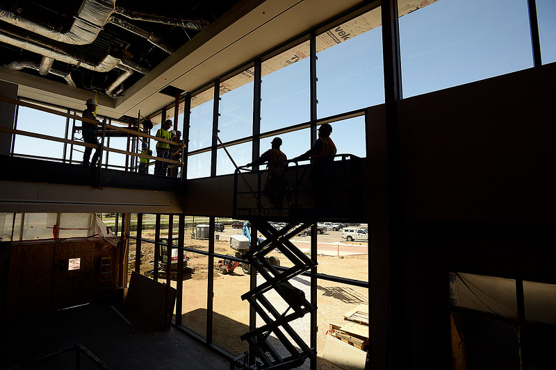 Constructions crews work on the new Larimer County building under construction Friday, April 27, 2018, in Loveland.    (Photo by Jenny Sparks/Loveland Reporter-Herald)