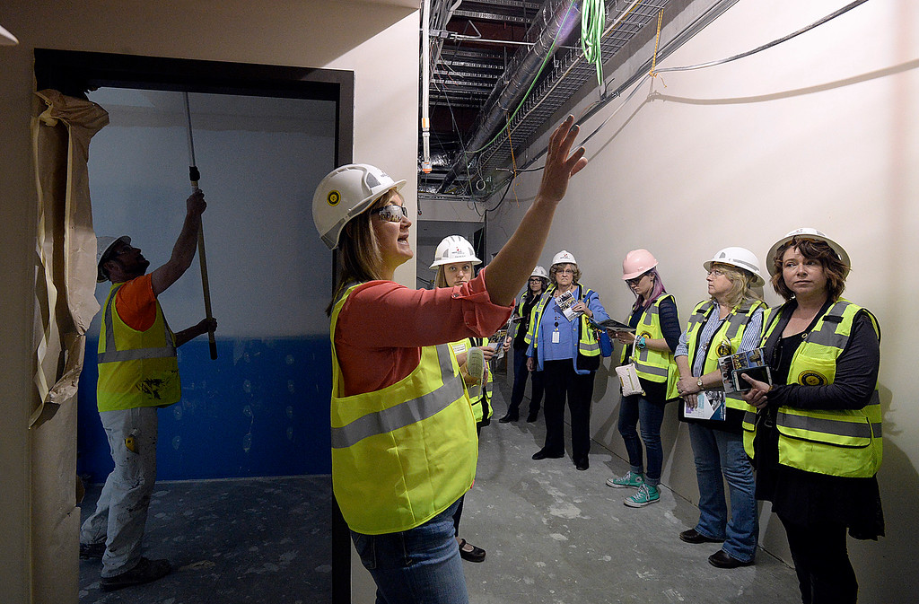 . Jennifer Johnson, Larimer County facilities planning and realestate manager, talks about the employee areas as she gives a tour of the new Larimer County building under construction Friday, April 27, 2018, in Loveland. The Larimer County commissioners and other county employees who work in Loveland and Fort Collins took tours of the new building.   (Photo by Jenny Sparks/Loveland Reporter-Herald)