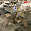 A new furniture store called Sam's Furniture & Liquidation Outlet has opening in the former Shaw's Supermarket space in Leominster. One of the dinning room tables and chairs they sell. SENTINEL & ENTERPRISE/JOHN LOVE