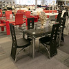 A new furniture store called Sam's Furniture & Liquidation Outlet has opening in the former Shaw's Supermarket space in Leominster. A dinning room table they have for sale in the new shop. SENTINEL & ENTERPRISE/JOHN LOVE
