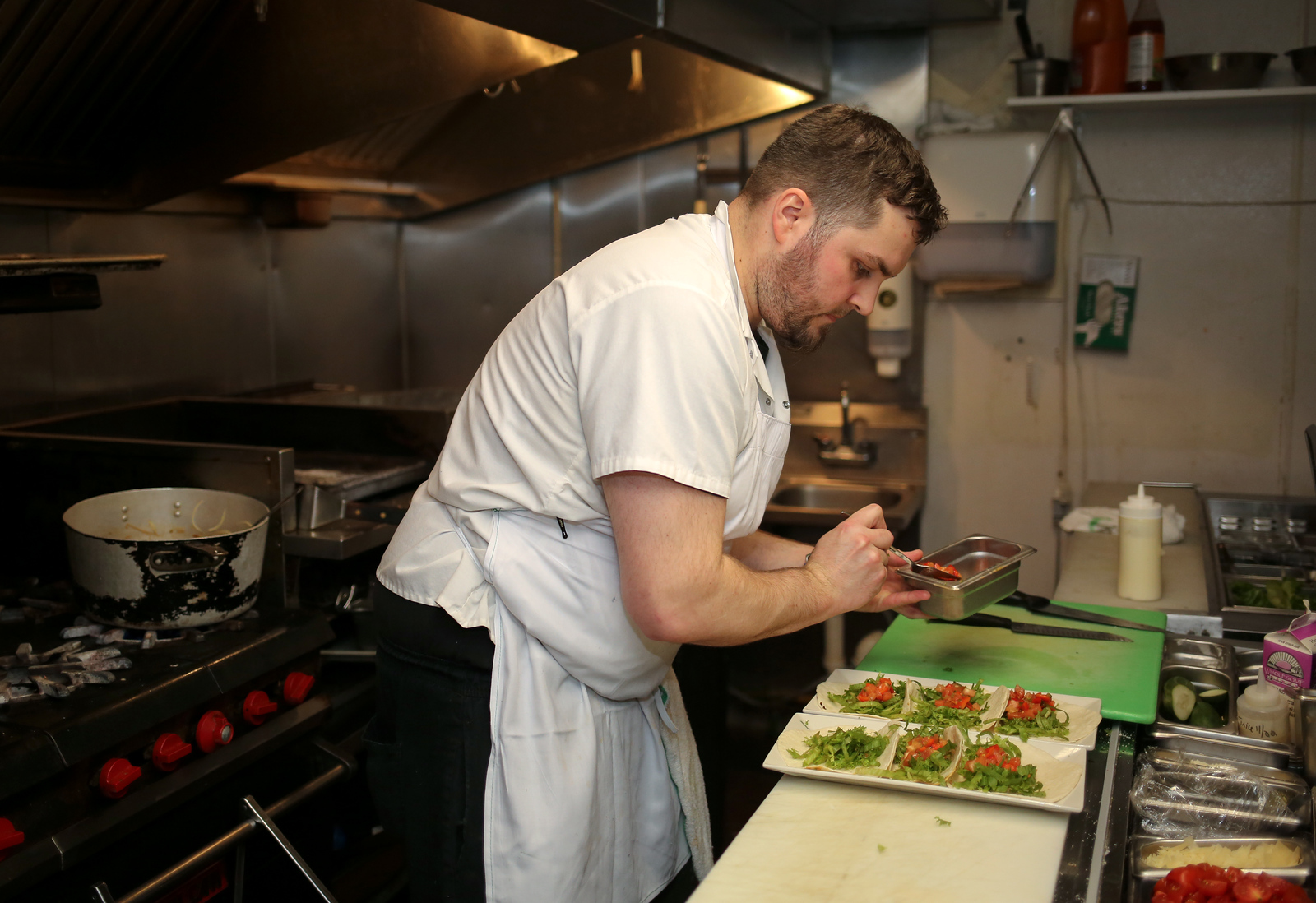 Executive chef Justin LaCapria in the kitchen at Crown and Hammer Restaurant and Pub. <br /> Photo by John Fitts